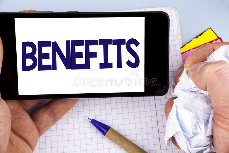 Handwriting text writing Benefits. Concept meaning hike in allowance for senior employees of the company written on Mobile Phone S. Handwriting text writing royalty free stock photo