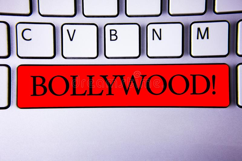 Handwriting text writing Bollywood Motivational Call. Concept meaning Hollywood Movie Film Entertainment Cinema Keyboard red key I. Ntention create creating royalty free stock photo