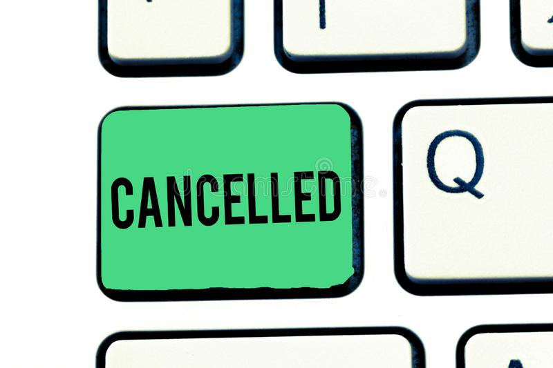 Handwriting text writing Cancelled. Concept meaning decide or announce that planned event will not take place Keyboard. Key Intention to create computer message stock photography