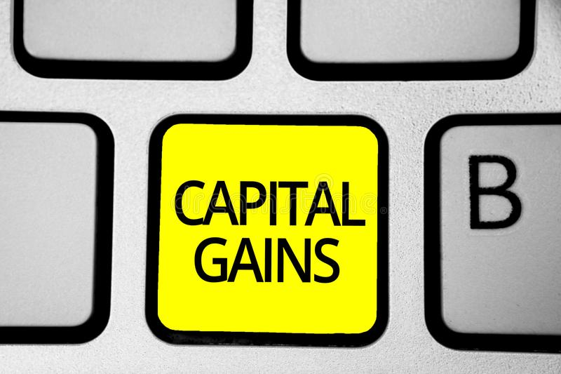 Handwriting text writing Capital Gains. Concept meaning Bonds Shares Stocks Profit Income Tax Investment Funds Keyboard yellow key. Intention create computer stock image
