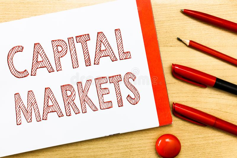 Handwriting text writing Capital Markets. Concept meaning Allow businesses to raise funds by providing market security royalty free stock image