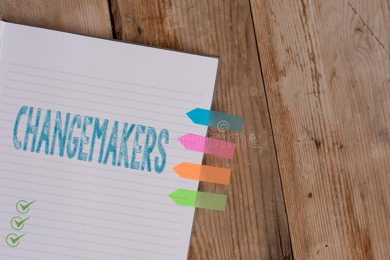 Handwriting text writing Changemakers. Concept meaning Young Turk Influencers Acitivists Urbanization Fashion Gen X Striped note. Handwriting text writing royalty free stock photos