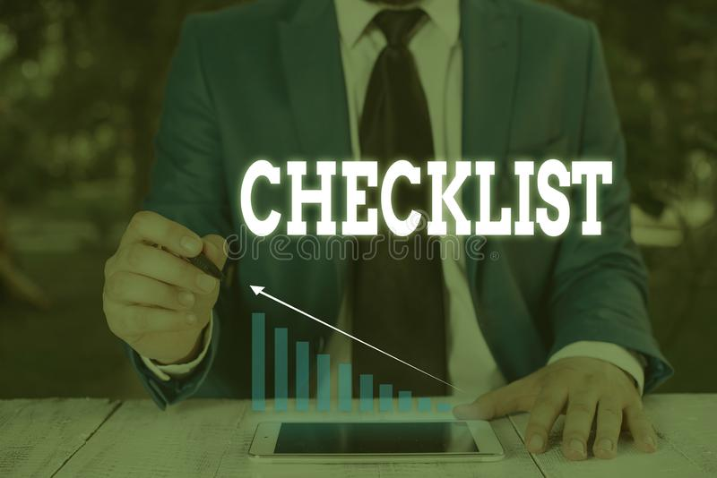 Handwriting text writing Checklist. Concept meaning List down of the detailed activity as guide of doing something Male. Handwriting text writing Checklist stock image
