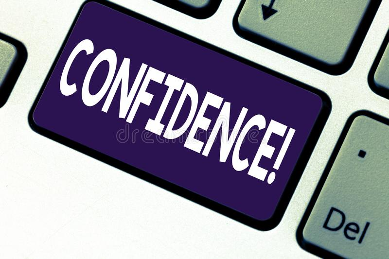 Handwriting text writing Confidence. Concept meaning Never ever doubting your worth,inspire and transform yourself. Keyboard key Intention to create computer stock images