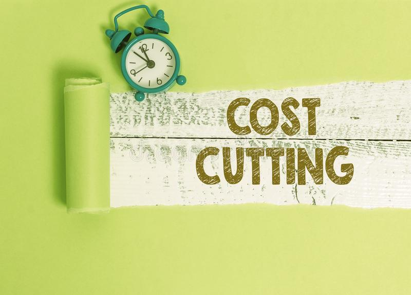 Handwriting text writing Cost Cutting. Concept meaning actions taken to reduce the amount that is spent on a service. Handwriting text writing Cost Cutting royalty free stock image
