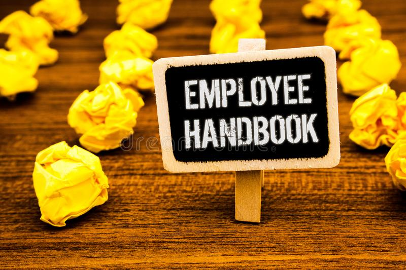 Handwriting text writing Employee Handbook. Concept meaning Document Manual Regulations Rules Guidebook Policy Code White text bla. Ck paint wooden board clip stock photography