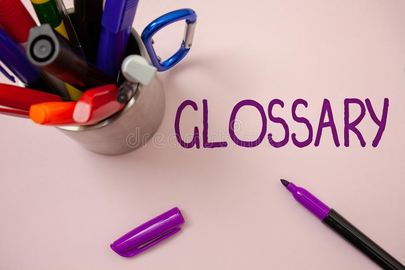 Handwriting text writing Glossary. Concept meaning Alphabetical list of terms with meanings Vocabulary Descriptions White backgrou. Nd purple pen markers ideas royalty free stock photography