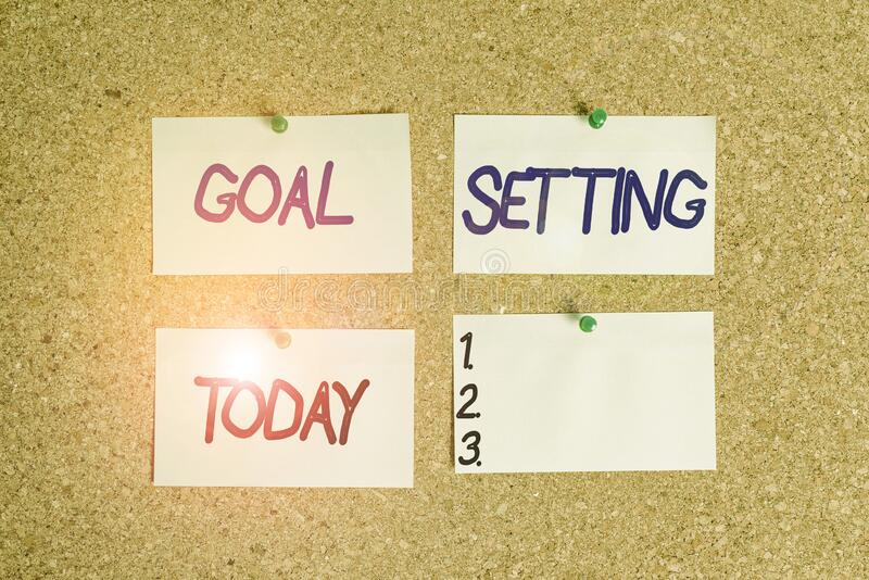 Handwriting text writing Goal Setting. Concept meaning process of identifying something that you want to accomplish Corkboard. Handwriting text writing Goal stock image