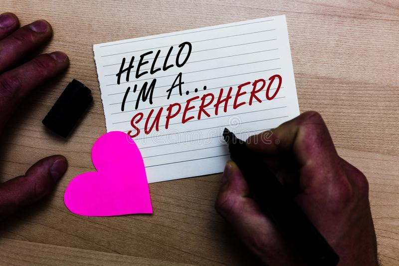 Handwriting text writing Hello I am A ... Superhero. Concept meaning Special powers Cartoon character Customs strenght Written on. Notepad hand hold marker with royalty free stock photo
