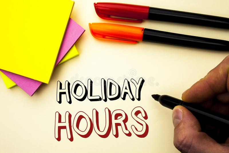 Handwriting text writing Holiday Hours. Concept meaning Celebration Time Seasonal Midnight Sales Extra-Time Opening written by Mar. Ker the plain background Pen stock image