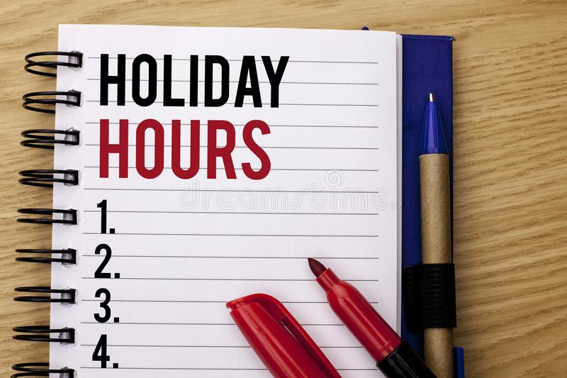 Handwriting text writing Holiday Hours. Concept meaning Celebration Time Seasonal Midnight Sales Extra-Time Opening written on Not. Handwriting text writing stock photos