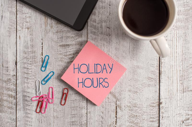 Handwriting text writing Holiday Hours. Concept meaning employee receives twice their normal pay for all hours. Handwriting text writing Holiday Hours stock image