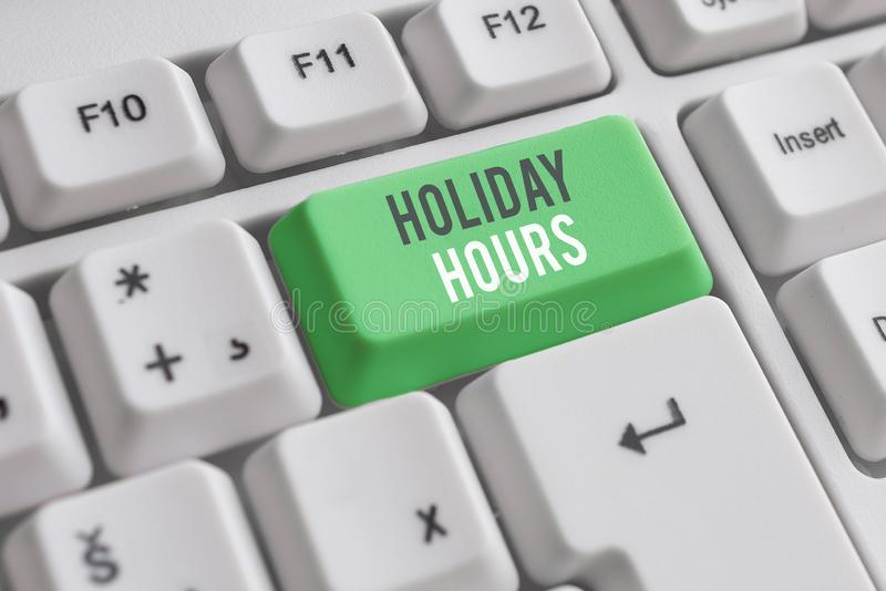 Handwriting text writing Holiday Hours. Concept meaning employee receives twice their normal pay for all hours White pc. Handwriting text writing Holiday Hours stock image
