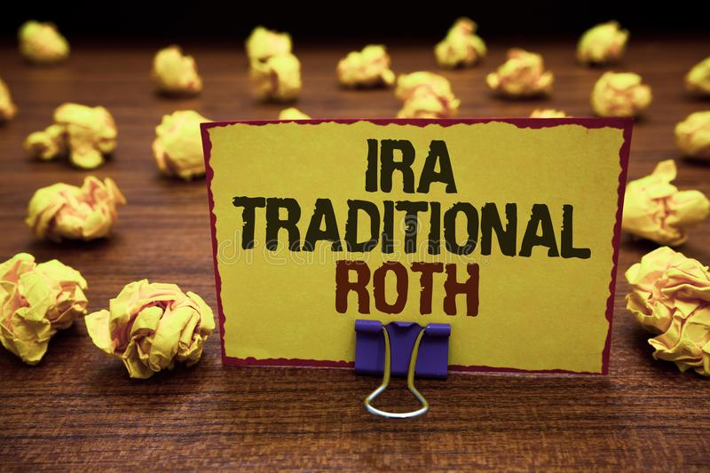 Handwriting text writing Ira Traditional Roth. Concept meaning are tax deductible on both state and federal Yellow sticky card cli. Pped text notice crumpled royalty free stock image