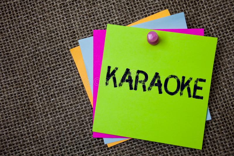 Handwriting text writing Karaoke. Concept meaning Entertainment singing along instrumental music played by a machine Sticky cards stock photos