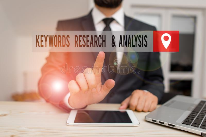 Handwriting text writing Keywords Research And Analysis. Concept meaning search for data and create tables graphs. Handwriting text writing Keywords Research royalty free stock photo
