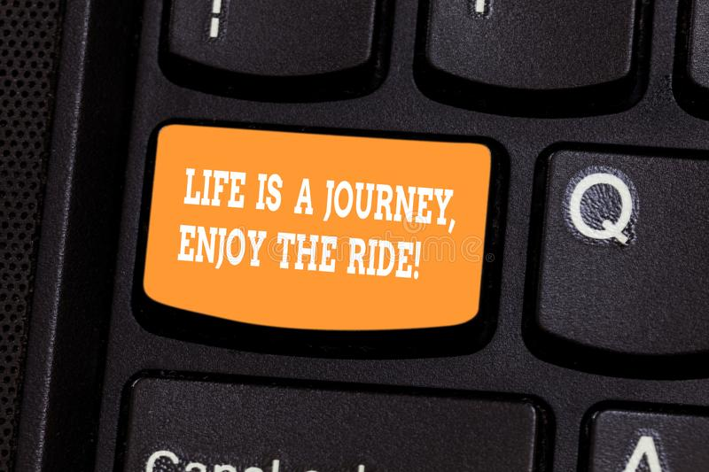 Handwriting text writing Life Is A Journey Enjoy The Ride. Concept meaning Enjoying things that happen everyday Keyboard. Key Intention to create computer stock images