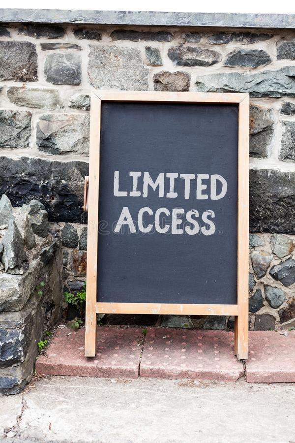 Handwriting text writing Limited Access. Concept meaning Having access restricted to a quite small number of points. Handwriting text writing Limited Access stock photo