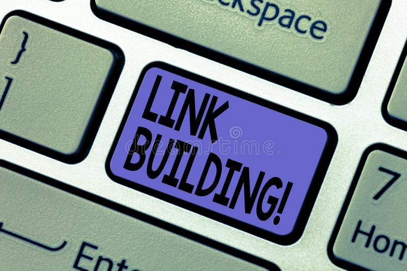 Handwriting text writing Link Building. Concept meaning Process of acquiring hyperlinks from other websites Connection. Keyboard key Intention to create royalty free stock photography