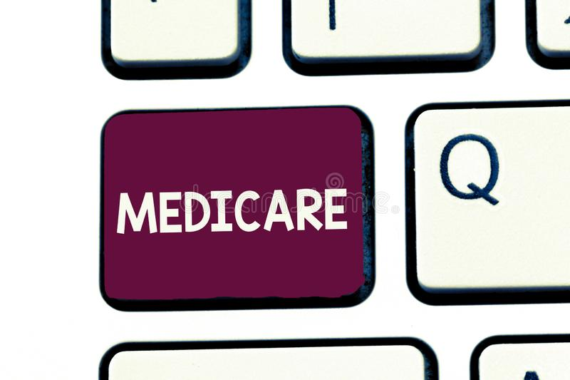 Handwriting text writing Medicare. Concept meaning federal government plan in us for paying certain hospital.  stock photos