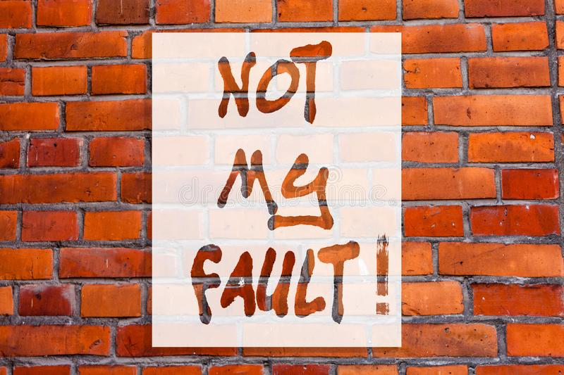 Handwriting text writing Not My Fault. Concept meaning To make excuses to avoid being accused for a mistake error Brick. Wall art like Graffiti motivational royalty free stock images