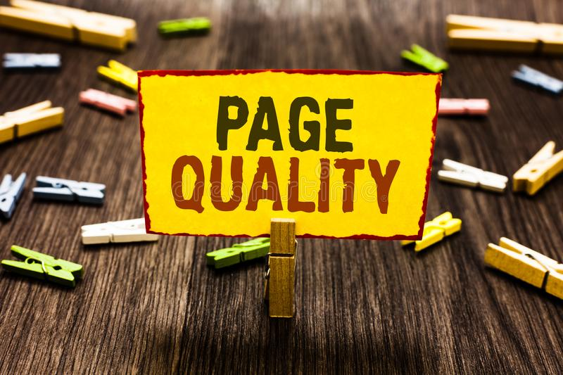 Handwriting text writing Page Quality. Concept meaning Effectiveness of a website in terms of appearance and function Clothespin h. Olding yellow paper note royalty free stock photo