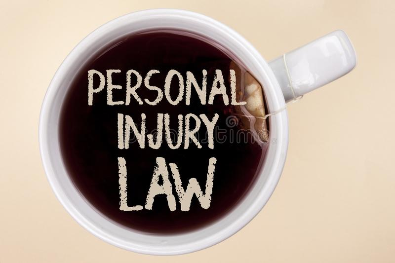 Handwriting text writing Personal Injury Law. Concept meaning guarantee your rights in case of hazards or risks written on Tea in. Handwriting text writing stock photography