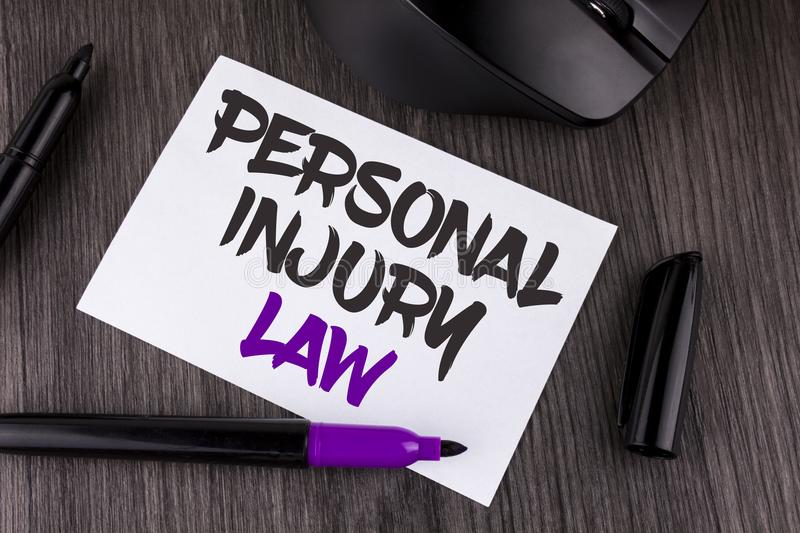 Handwriting text writing Personal Injury Law. Concept meaning guarantee your rights in case of hazards or risks written on White S. Handwriting text writing stock image