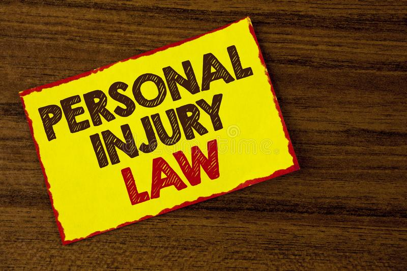 Handwriting text writing Personal Injury Law. Concept meaning guarantee your rights in case of hazards or risks written on Yellow. Handwriting text writing stock photo