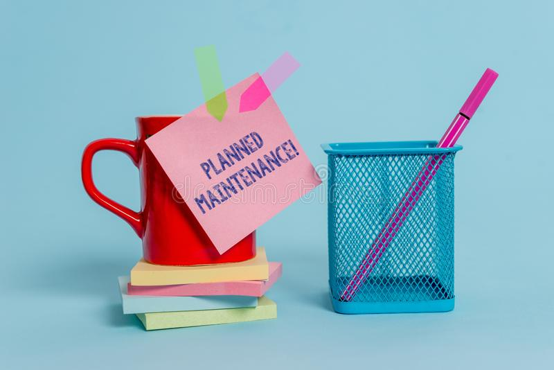 Handwriting text writing Planned Maintenance. Concept meaning Check ups to be done Scheduled on a Regular Basis Cup note. Handwriting text writing Planned stock image