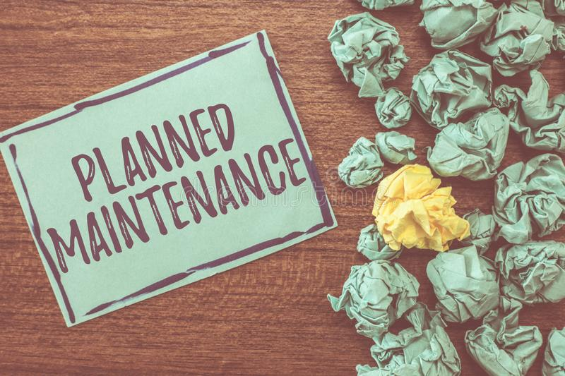 Handwriting text writing Planned Maintenance. Concept meaning Check ups to be done Scheduled on a Regular Basis.  stock images