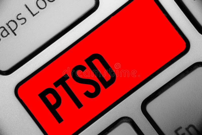 Handwriting text writing Ptsd. Concept meaning Post Traumatic Stress Disorder Mental Illness Trauma Fear Depression Keyboard grey. Key silver laptop computer stock photography