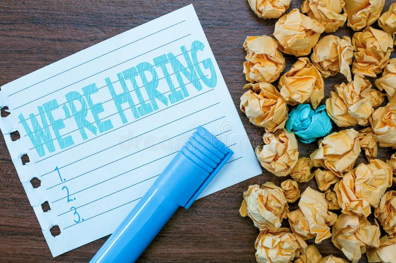 Handwriting text writing WE are RE HIRING. Concept meaning Need to employ someone Job vacancy Recruiting analysispower.  stock photo