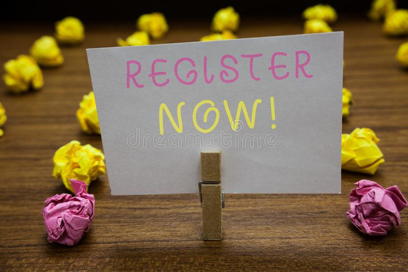 Handwriting text writing Register Now. Concept meaning Name in an Official List Enlist to be a Member Sign up Clothespin holding w. Hite paper note crumpled stock photo