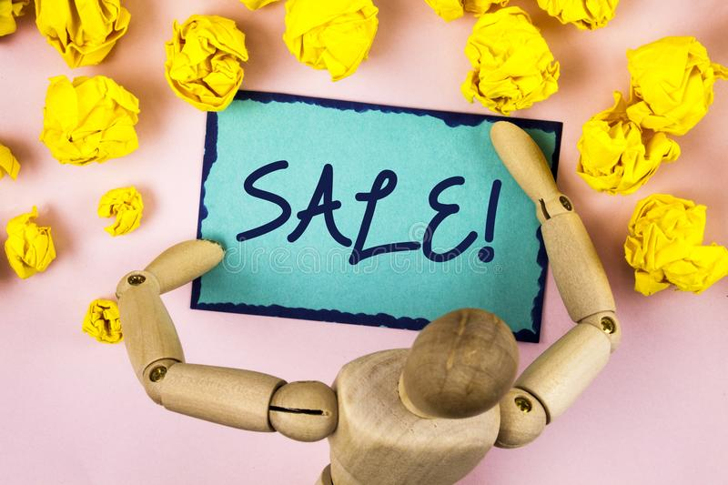 Handwriting text writing Sale Motivational Call. Concept meaning Selling goods at reduced prices Make a Sell written on Sticky not royalty free stock photo