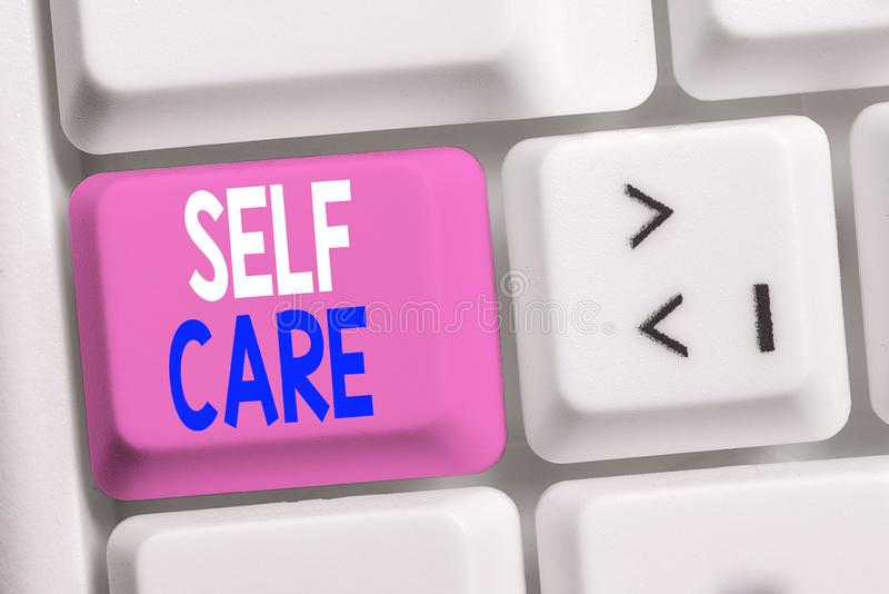Handwriting text writing Self Care. Concept meaning the practice of taking action to improve one s is own health White pc keyboard. Handwriting text writing Self stock photo
