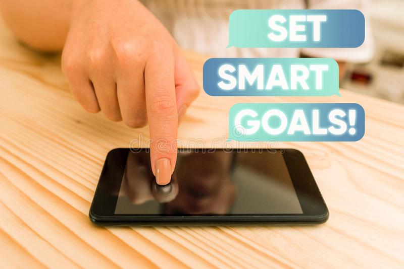Handwriting text writing Set Smart Goals. Concept meaning list to clarify your ideas focus efforts use time wisely woman. Handwriting text writing Set Smart stock images