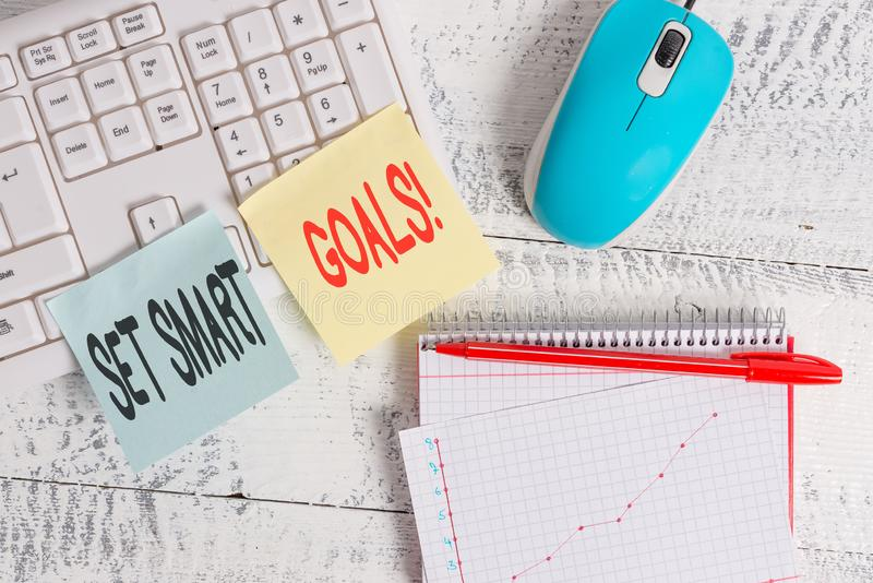 Handwriting text writing Set Smart Goals. Concept meaning list to clarify your ideas focus efforts use time wisely. Handwriting text writing Set Smart Goals stock image