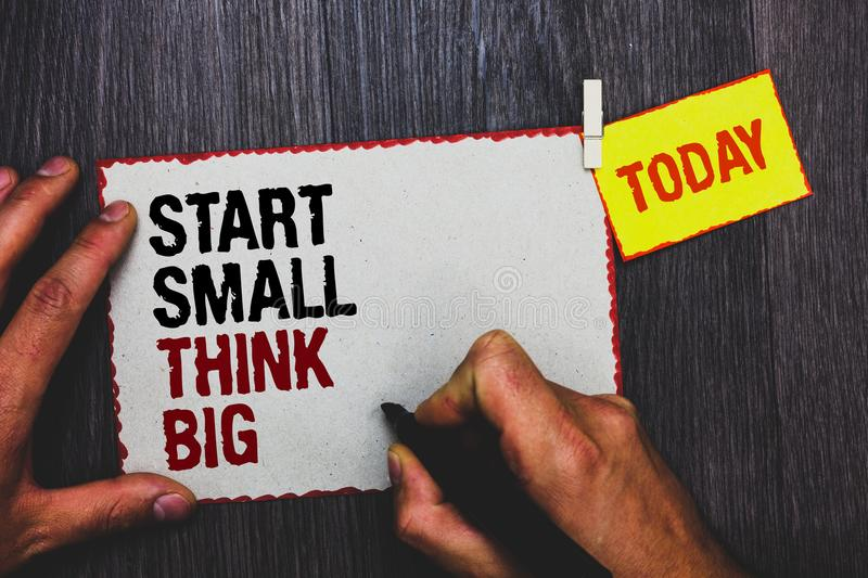 Handwriting text writing Start Small Think Big. Concept meaning Initiate with few things have something great in mind Hand grip bl. Ack marker writing text royalty free stock photo