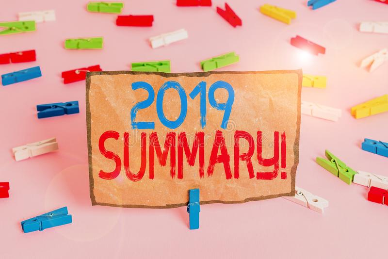 Handwriting text writing 2019 Summary. Concept meaning summarizing past year events main actions or good shows Colored clothespin. Handwriting text writing 2019 stock image