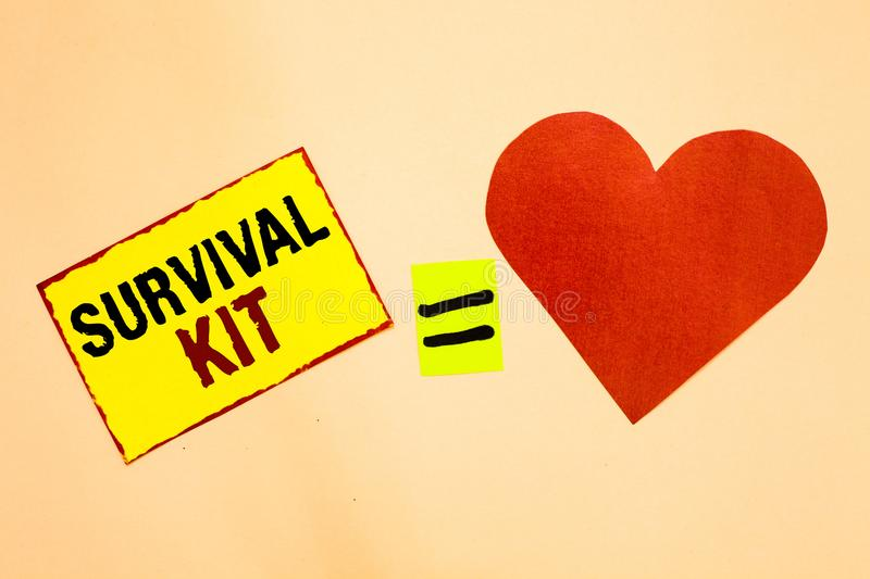 Handwriting text writing Survival Kit. Concept meaning Emergency Equipment Collection of items to help someone Yellow piece paper. Reminder equal sign red heart royalty free stock photos