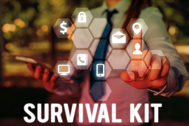 Handwriting text writing Survival Kit. Concept meaning Emergency Equipment Collection of items to help someone. Handwriting text writing Survival Kit stock photos