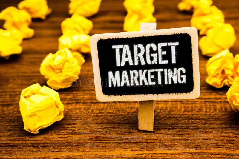 Handwriting text writing Target Marketing. Concept meaning Market Segmentation Audience Targeting Customer Selection White text bl. Ack paint wooden board clip royalty free stock photo
