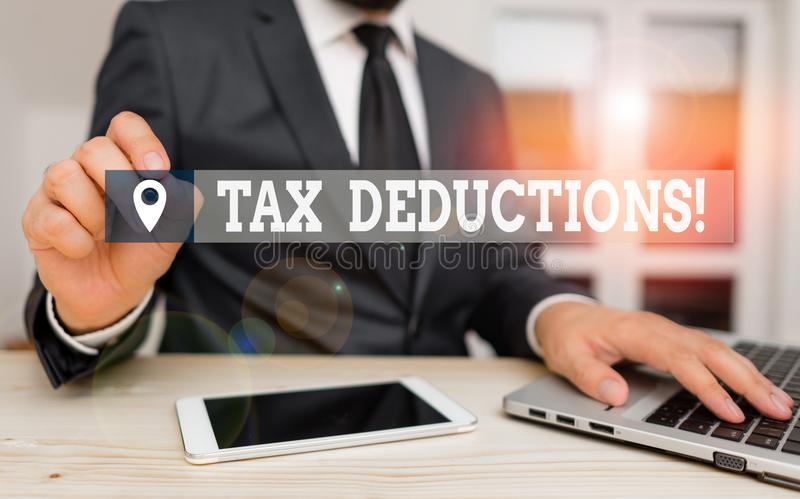Handwriting text writing Tax Deductions. Concept meaning reduction income that is able to be taxed of expenses Male. Handwriting text writing Tax Deductions royalty free stock photos