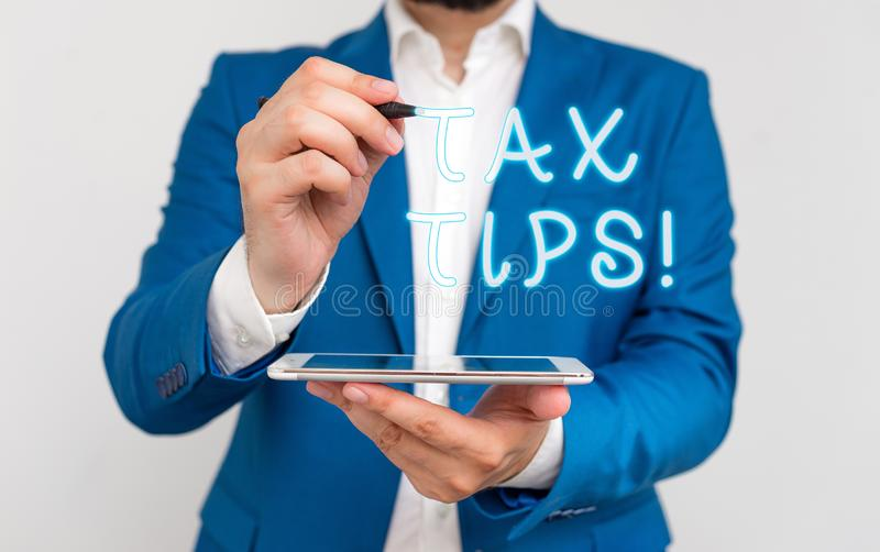 Handwriting text writing Tax Tips. Concept meaning compulsory contribution to state revenue levied by government. Handwriting text writing Tax Tips. Conceptual stock images