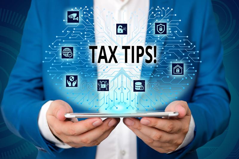 Handwriting text writing Tax Tips. Concept meaning compulsory contribution to state revenue levied by government Male. Handwriting text writing Tax Tips royalty free stock photos