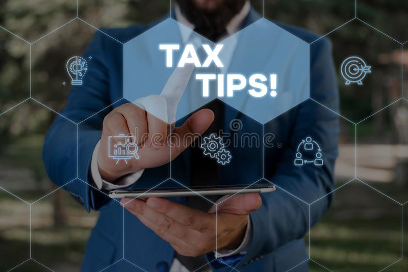 Handwriting text writing Tax Tips. Concept meaning compulsory contribution to state revenue levied by government Male. Handwriting text writing Tax Tips royalty free stock image