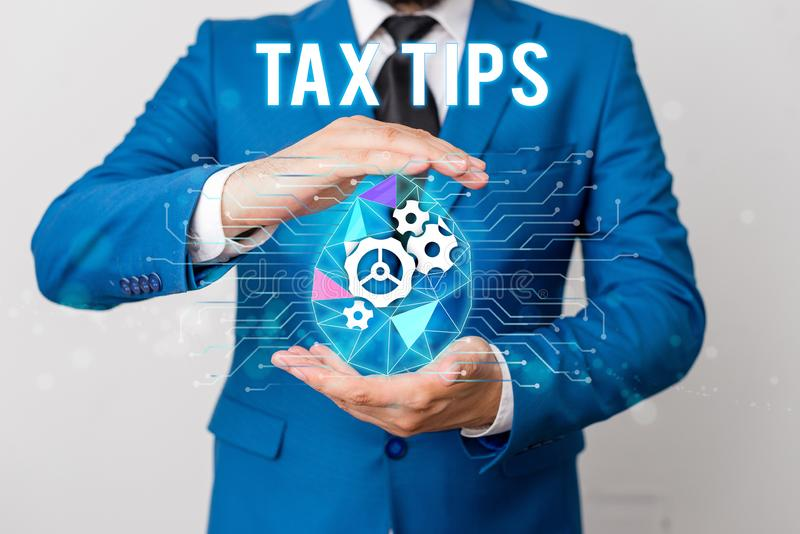 Handwriting text writing Tax Tips. Concept meaning compulsory contribution to state revenue levied by government Man net. Handwriting text writing Tax Tips royalty free stock photography