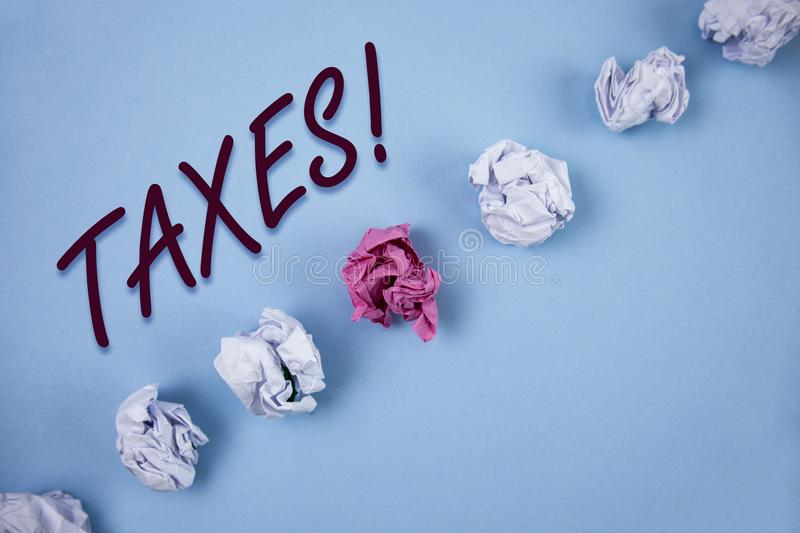 Handwriting text writing Taxes Motivational Call. Concept meaning Money demanded by a government for its support written on Plain. Handwriting text writing Taxes stock image