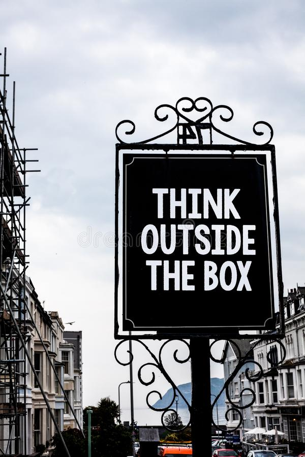 Handwriting text writing Think Outside The Box. Concept meaning Thinking of new and creative solution leads to success Vintage bla royalty free stock image